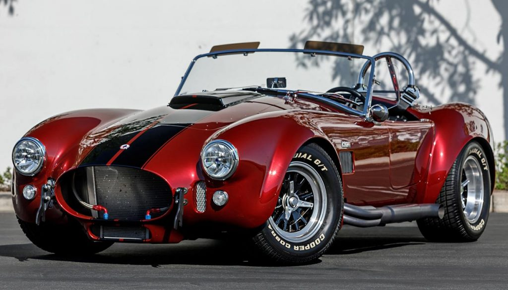 3/4-frontal view of Sunset Red Superformance Shelby 427SC Cobra for sale, SPO3054