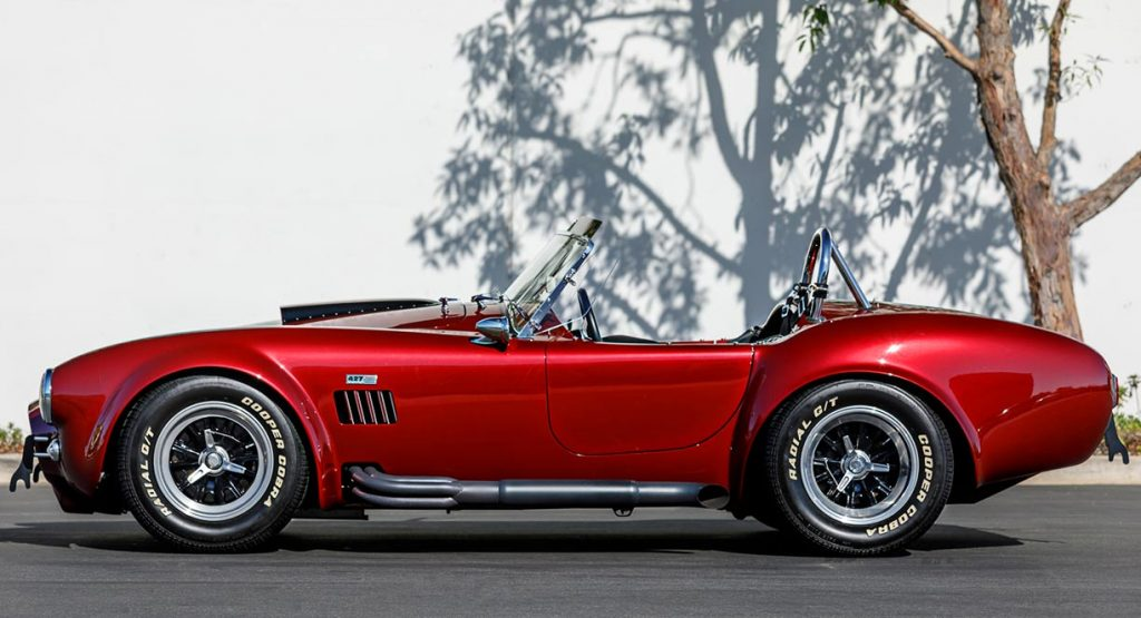 broadside view of Sunset Red Superformance Shelby 427SC Cobra for sale
