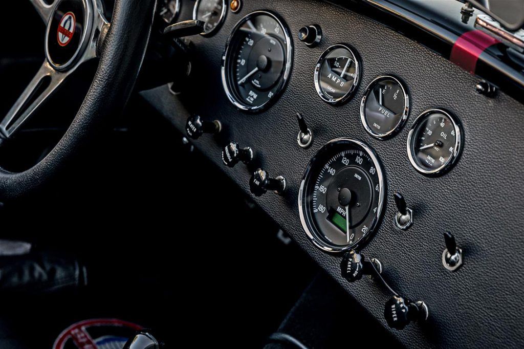 dashboard shot of Sunset Red Superformance Shelby 427SC Cobra for sale