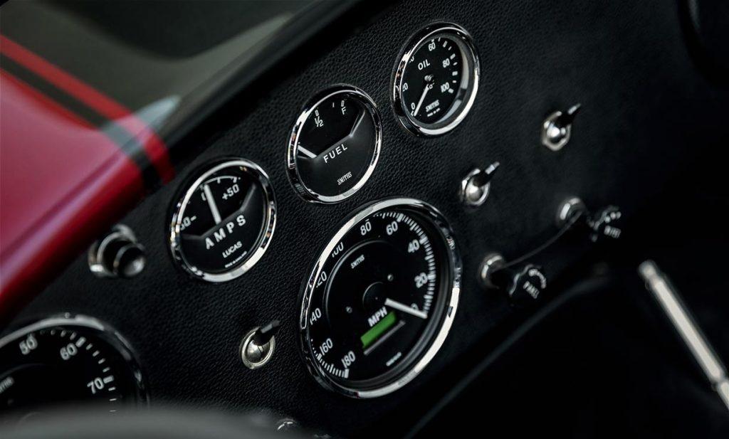dashboard gauges shot of Sunset Red Superformance Shelby 427SC Cobra