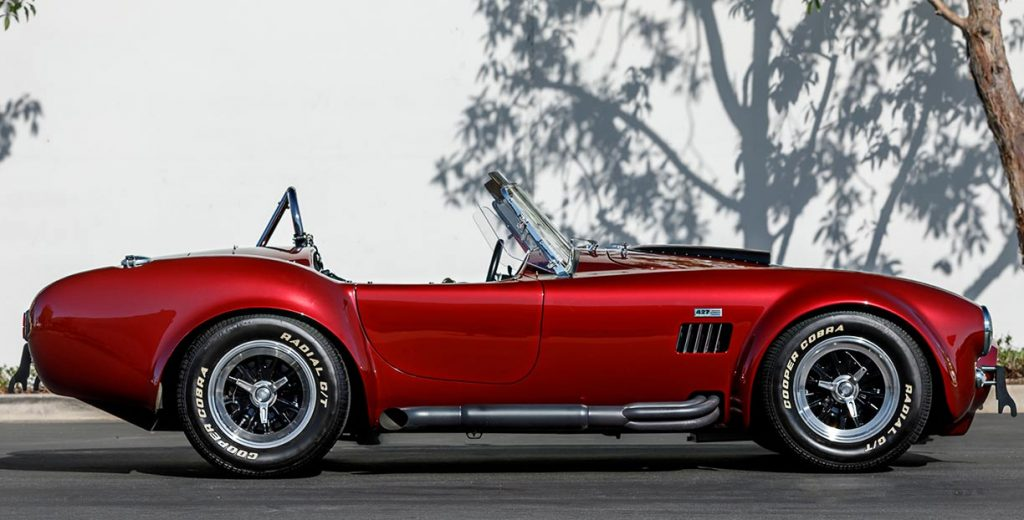 passenger-side photo of Sunset Red Superformance Shelby 427SC Cobra for sale