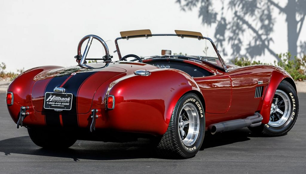 3/4-rear view of Sunset Red Superformance Shelby 427SC Cobra for sale