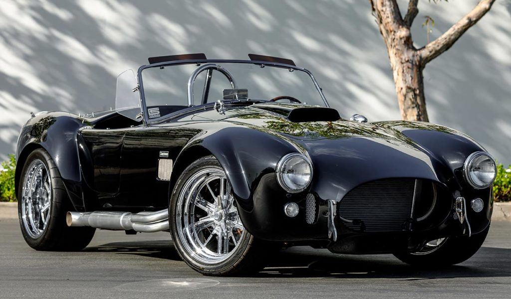 3/4-frontal shot (passenger side) of Onyx Black Superformance 427SC Shelby Cobra vehicle for sale, SPO3357