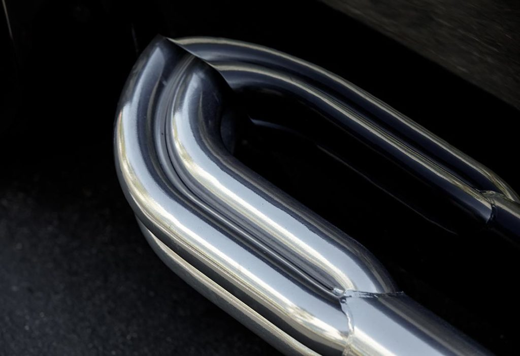 closeup shot of chromed sidepipe on Onyx Black Superformance 427SC Shelby Cobra vehicle for sale, SPO3357