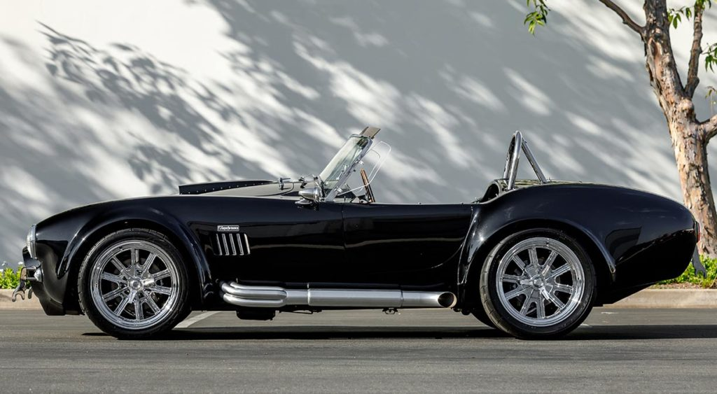 broadside shot (driver side) of Onyx Black Superformance 427SC Shelby Cobra vehicle for sale, SPO3357