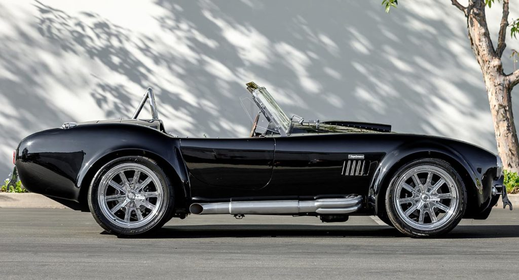 broadside shot (passenger side) of Onyx Black Superformance 427SC Shelby Cobra vehicle for sale, SPO3357