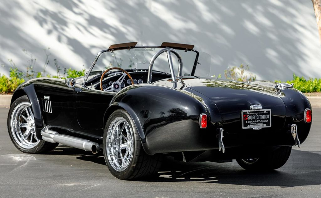 3/4-rear shot (driver side) of Onyx Black Superformance 427SC Shelby Cobra vehicle for sale, SPO3357