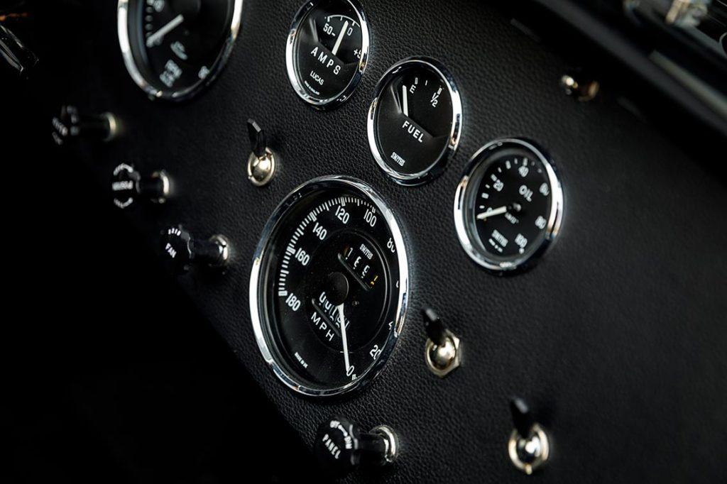 closeup/macro shot of instrument gauges on black-on-black Superformance 427SC Cobra for sale, SPO3367