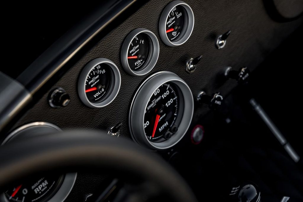 closeup of dashboard instruments of Grigio Silverstone Superformance 427SC Cobra for sale, SPO3392