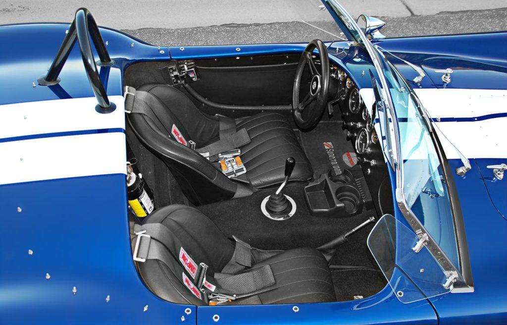cockpit shot (from passenger side) of Royal Blue/Arctic White LeMans stripes Superformance 427SC Shelby classic Cobra for sale, SPO#0874