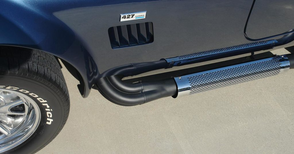 closeup shot of sidepipe and chromed ankle guard on this Corinthian Blue Everett-Morrison 427SC Cobra for sale by owner