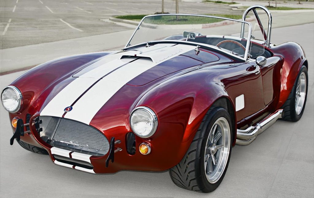 3/4-frontal (driver side) photo of Ruby Red Metallic Factory Five Racing pre-owned 427SC Mk4 Shelby Cobra classic vehicle for sale