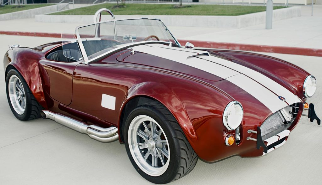 3/4-frontal (passenger side) photo of Ruby Red Metallic Factory Five Racing pre-owned 427SC Mk4 Shelby Cobra classic vehicle for sale