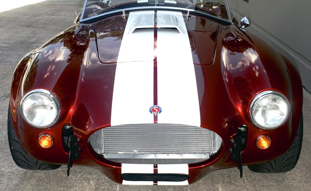 frontal shot of Ruby Red Metallic Factory Five Racing pre-owned 427SC Mk4 Shelby Cobra classic vehicle for sale