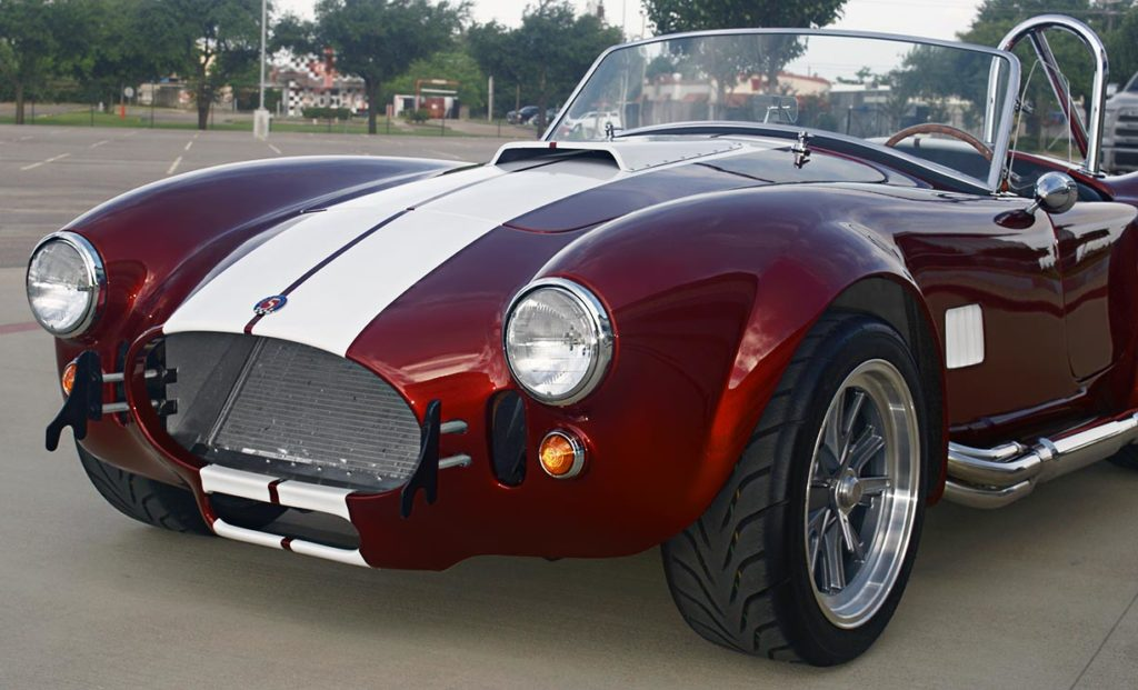 front-quarter (driver side) photo of Ruby Red Metallic Factory Five Racing pre-owned 427SC Mk4 Shelby Cobra classic vehicle for sale