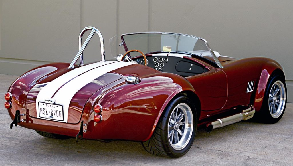 3/4-rear (passenger side) photo of Ruby Red Metallic Factory Five Racing pre-owned 427SC Mk4 Shelby Cobra classic vehicle for sale