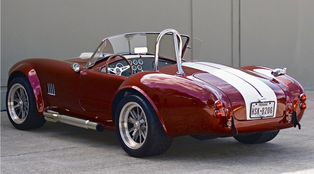 3/4-rear photo (driver side) of Ruby Red Metallic Factory Five Racing pre-owned 427SC Mk4 Shelby Cobra classic vehicle for sale
