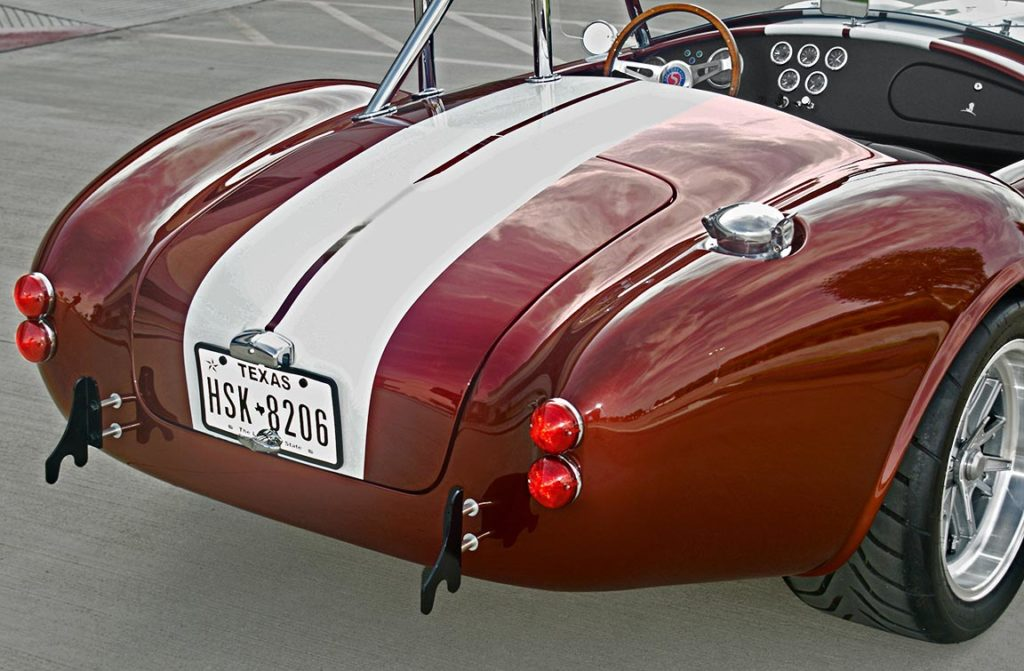 rear-quarter photo (passenger side) of Ruby Red Metallic Factory Five Racing pre-owned 427SC Mk4 Shelby Cobra classic vehicle for sale