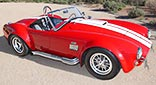 thumbnail image (broadside shot) of Monza Red Superformance 427SC Shelby classic Cobra for sale, SPO2051