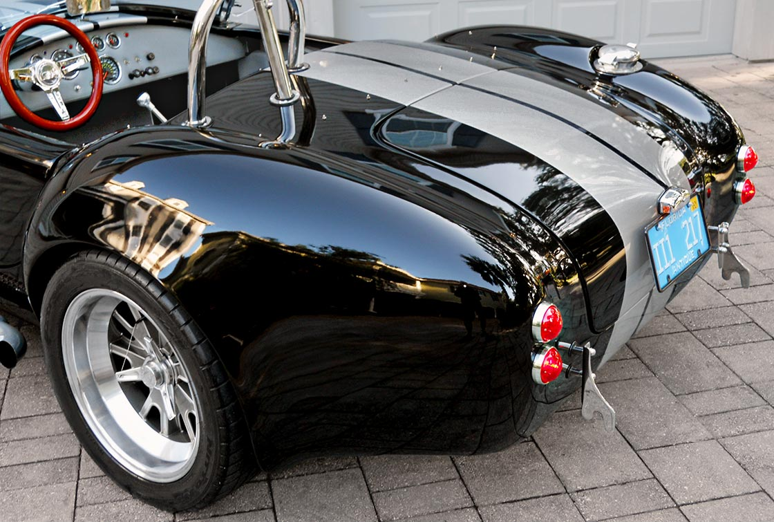 rear-quarter closeup shot (driver side) of Onyx Black/silver stripes 427SC Shelby classic Backdraft Racing (BDR#664) Cobra for sale by owner