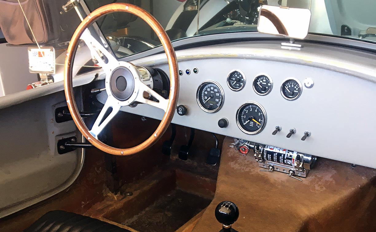 cockpit shot of gray-primered Shell Valley 427SC Shelby classic Cobra for sale by owner