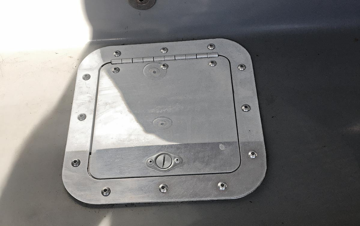 aluminum hinged door for easy access to the fuel tank sending unit of gray-primered Shell Valley 427SC Shelby classic Cobra for sale by owner