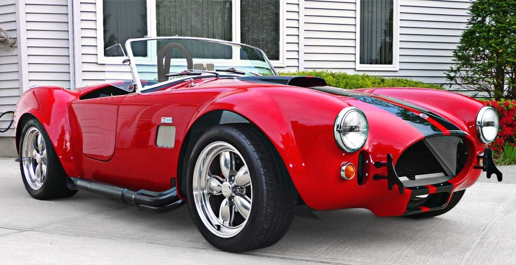 3/4-frontal (passenger side) photo of Ferrari Red Factory Five Racing 427SC Cobra for sale by owner