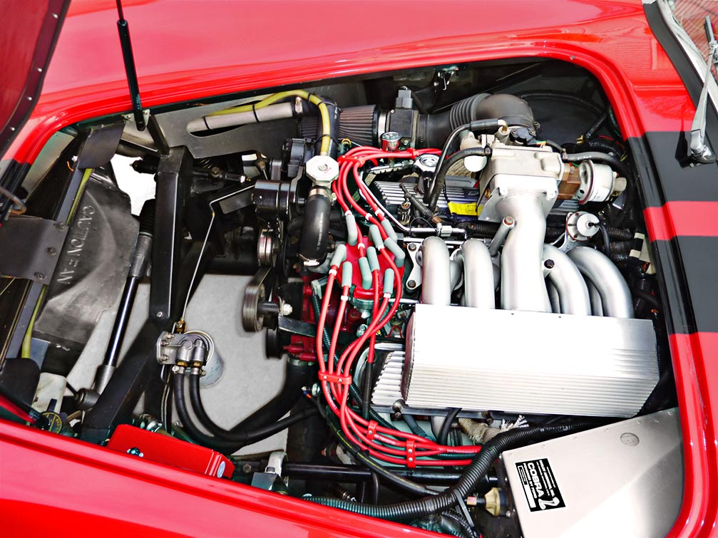 5.0L Ford Mustang engine photo of Ferrari Red Factory Five Racing 427SC Cobra for sale by owner
