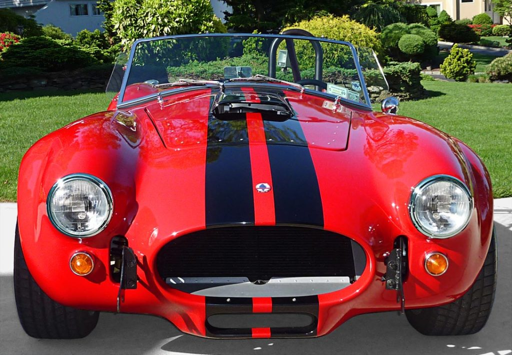 head-on frontal photo of Ferrari Red Factory Five Racing 427SC Cobra for sale by owner