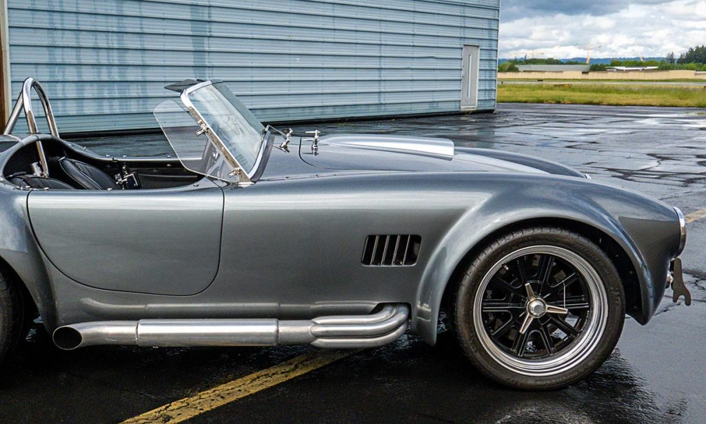 broadside shot (passenger side) of Dark Silver Superformance 427SC Shelby classic Cobra for sale, SPO2938