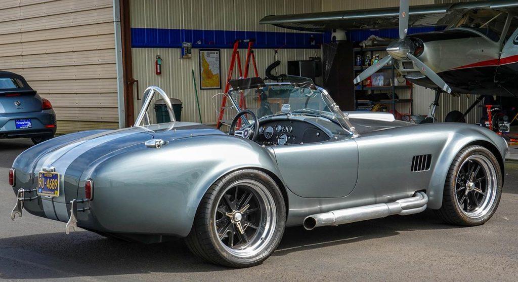 3/4-rear shot (passenger side) of Dark Silver Superformance 427SC Shelby classic Cobra for sale, SPO2938