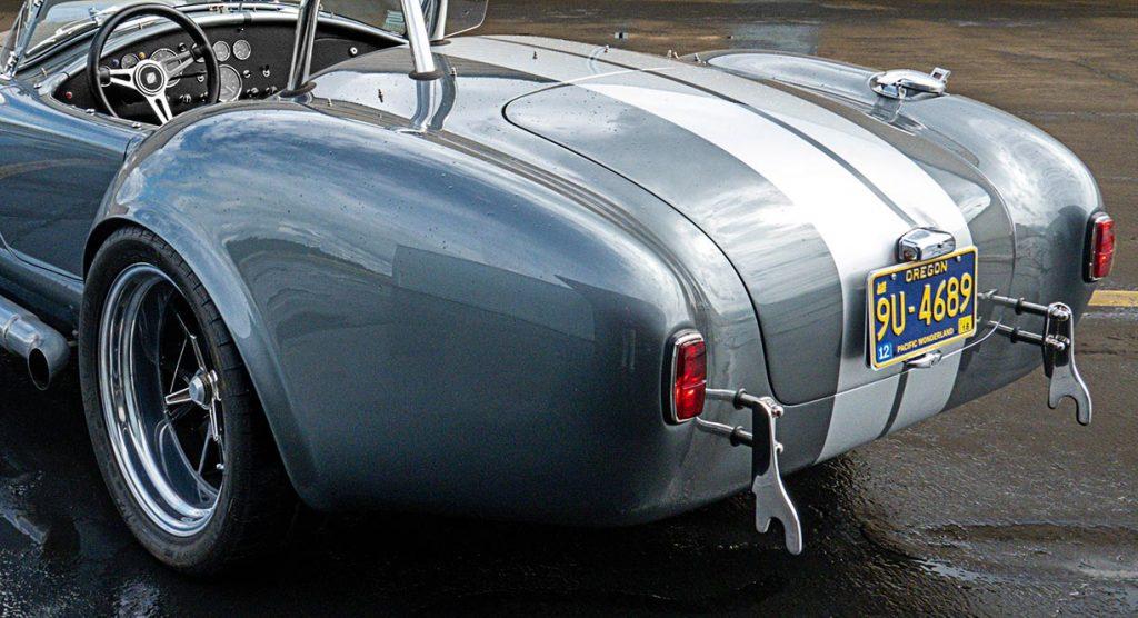 rear-quarter shot (driver side) of Dark Silver Superformance 427SC Shelby classic Cobra for sale, SPO2938
