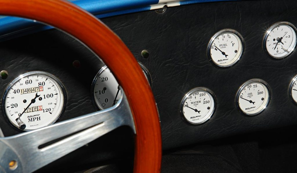 closeup photo of dashboard gauges of Wimbledon White JCF (John's Custom Fabrication) pre-owned Shelby classic Cobra for sale