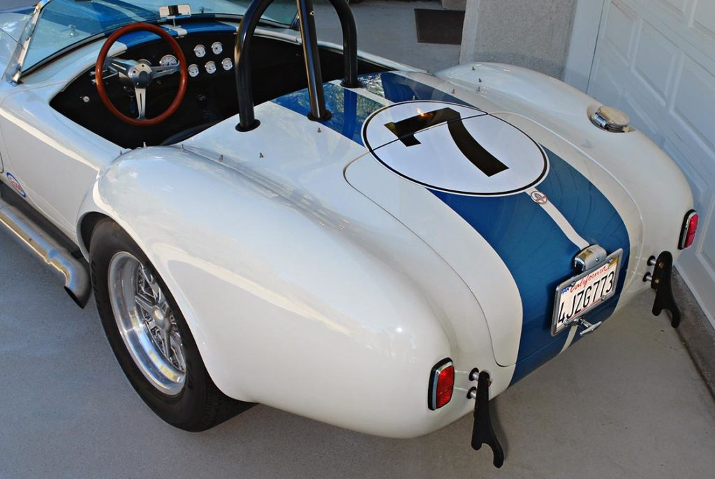 rear-quarter view (driver side) of Wimbledon White JCF (John's Custom Fabrication) pre-owned Shelby classic Cobra for sale
