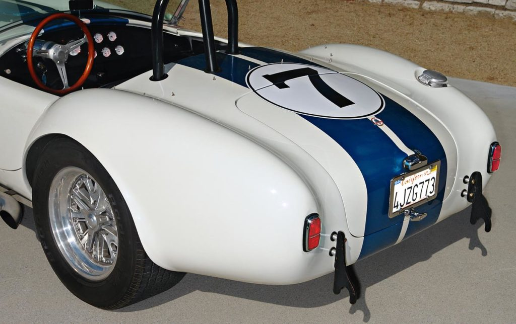 rear-quarter view (driver side, alternate camera angle) of Wimbledon White JCF (John's Custom Fabrication) pre-owned Shelby classic Cobra for sale