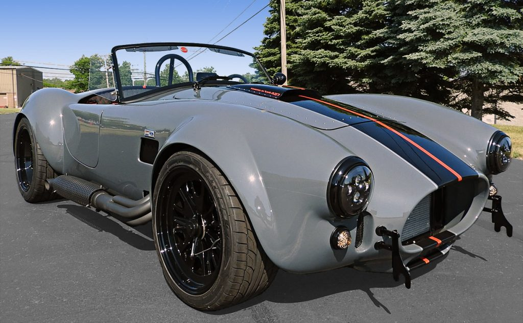 3/4-frontal view (passenger side) of Grigio Telestro/black LeMans stripes Backdraft Racing 427SC Shelby classic Cobra for sale, BDR1932