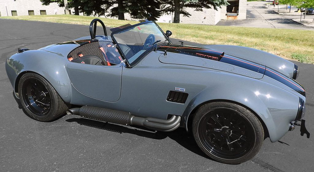 broadside shot (passenger side) of Grigio Telestro/black LeMans stripes Backdraft Racing 427SC Shelby classic Cobra for sale, BDR1932