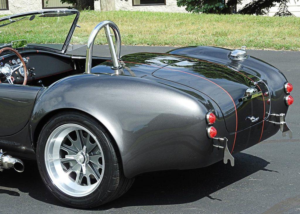 rear quarter shot (driver side) of Magnetic Gray/black LeMans stripes 427SC Backdraft Racing (classic Cobra replica) for sale, BDR2078