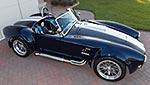 broadside shot (thumbnail sized) of Indigo Blue Backdraft Racing 427SC Shelby classic Cobra for sale, BDR838