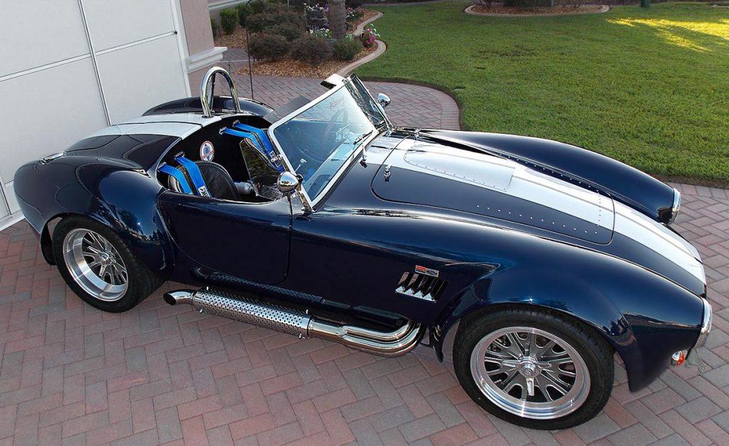 broadside shot (passenger side) of Indigo Blue Backdraft Racing 427SC Shelby classic Cobra for sale, BDR838