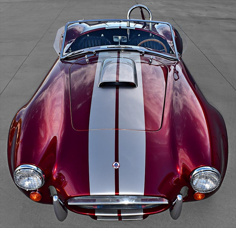 dramatic aerial/frontal shot of Candy Apple Red E.R.A. 427SC Shelby classic Cobra replica for sale