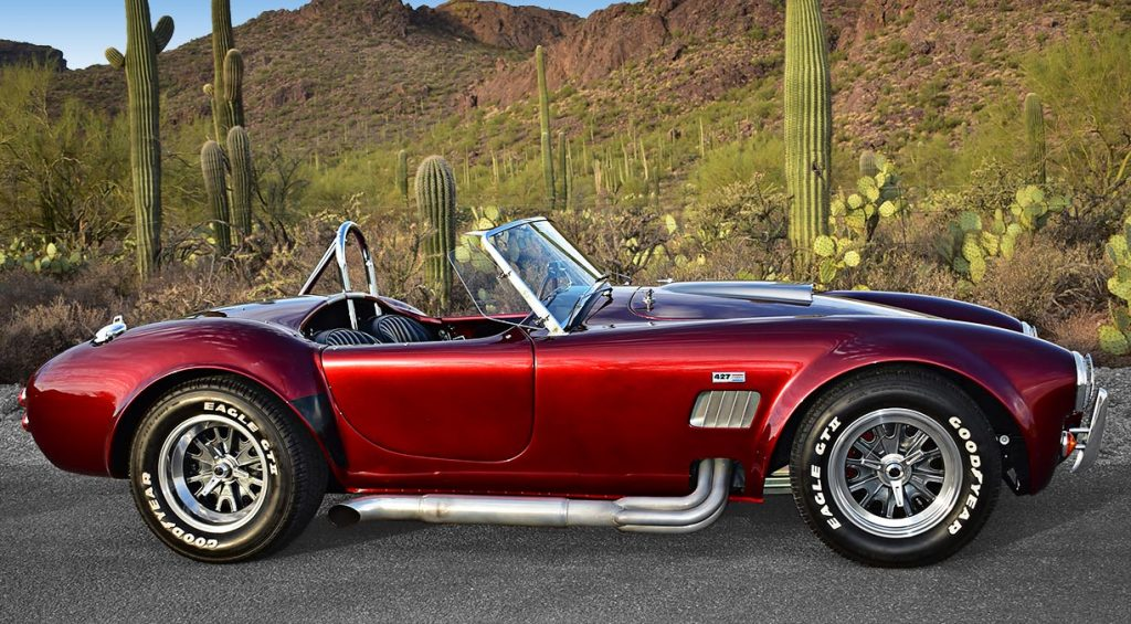 3/4-rear view of Sunset Red Superformance 427SC Shelby classic Cobra for sale, SPO2198