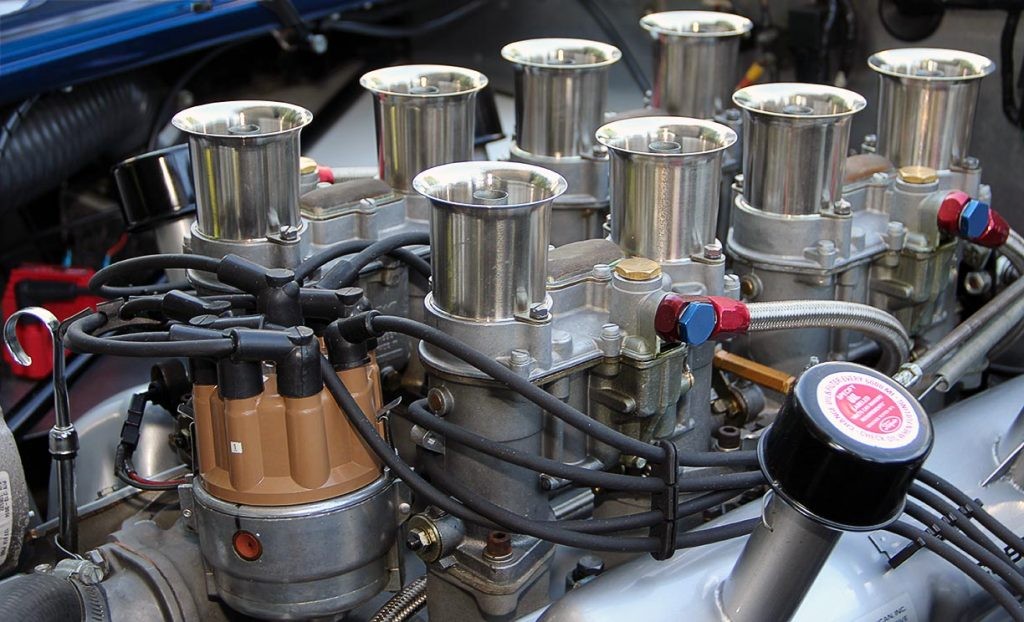 closeup photo of Weber 48IDA carburetor ensemble on 347cid small-block engine of Ford Dark Blue 289 USRRC E.R.A. (Shelby classic style) Cobra for sale