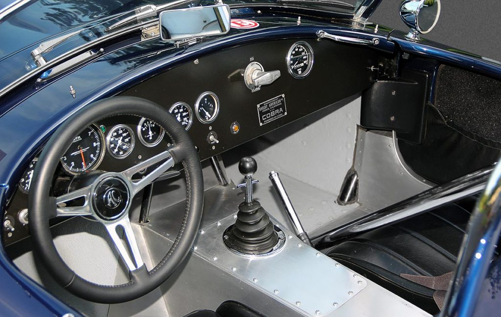 closeup cockpit shot (from driver side) of Ford Dark Blue 289 USRRC E.R.A. (Shelby classic style) Cobra for sale