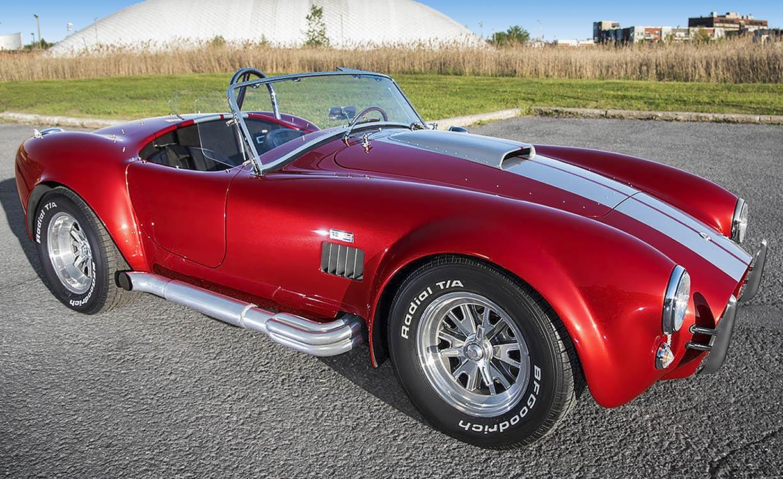 3/4-frontal shot (passenger side) of Sunset Red Superformance 427SC Shelby classic Cobra for sale, SPO2249