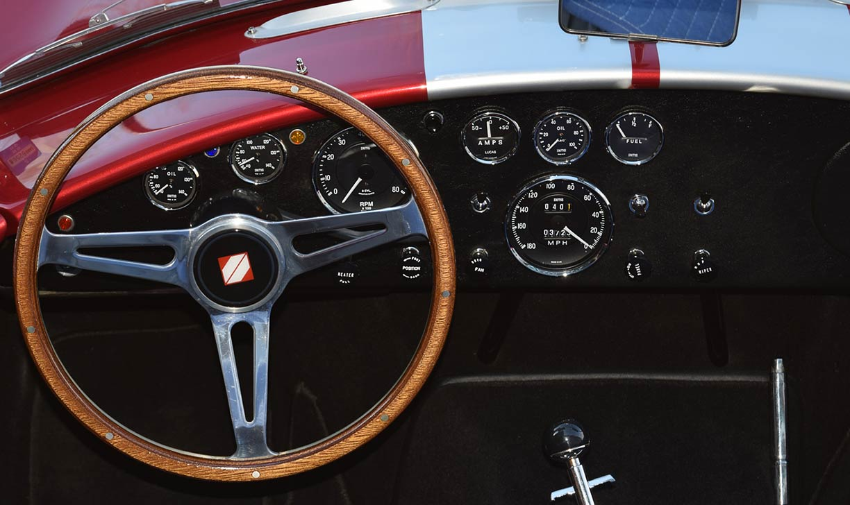 instrument panel shot of Sunset Red Superformance 427SC Shelby classic Cobra for sale, SPO2249