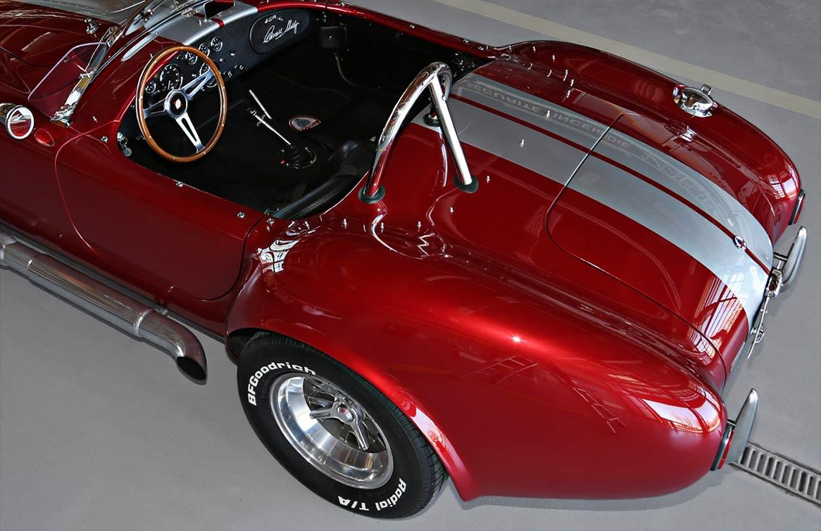 rear-quarter shot (driver side) of Sunset Red Superformance 427SC Shelby classic Cobra for sale, SPO2249
