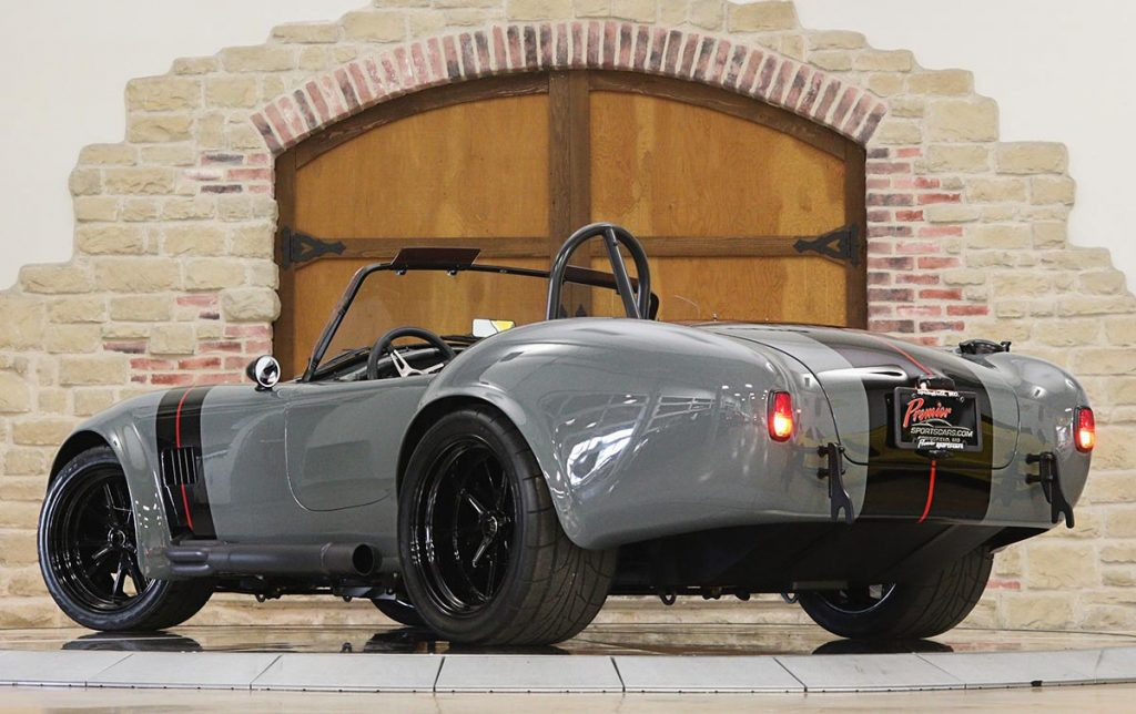 low-angle 3/4-rear view of Grigio Medio (medium gray) Superformance 427SC MkIII Shelby classic Cobra for sale, SPO3303