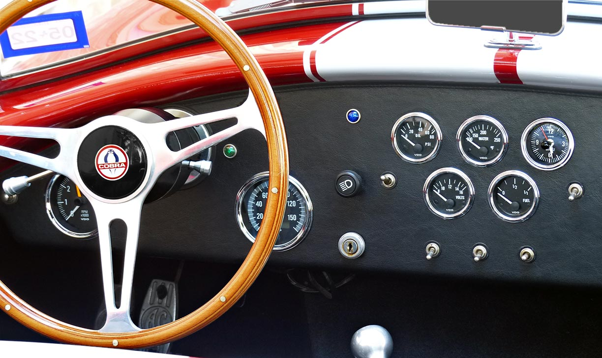 instrument panel shot of Rosso Corsa Red 427SC Shelby classic Shell Valley Cobra for sale by owner