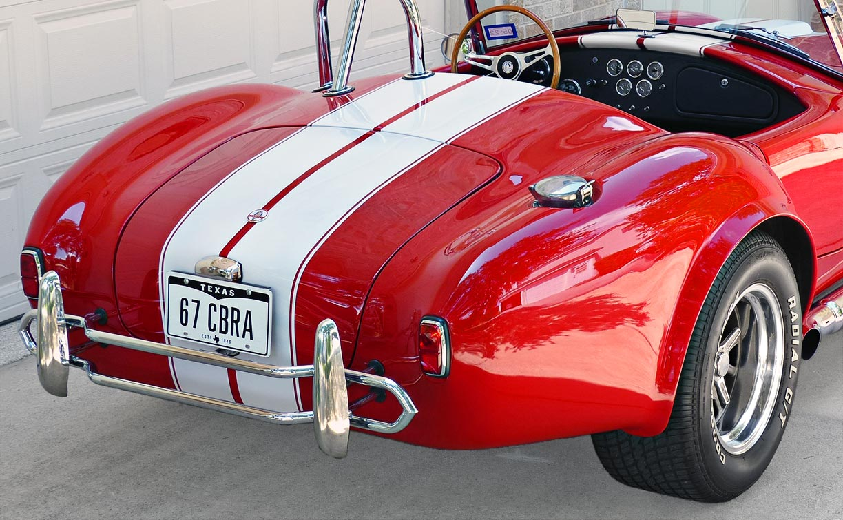 rear-quarter shot (driver side) of Rosso Corsa Red 427SC Shelby classic Shell Valley Cobra for sale by owner